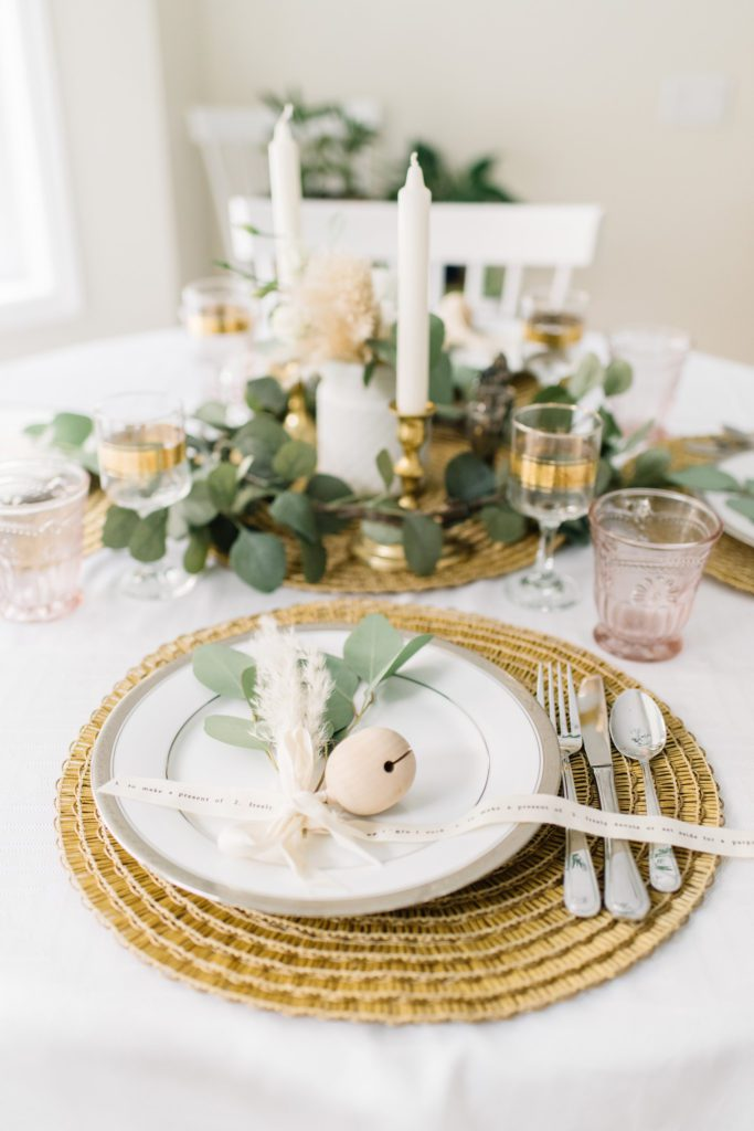 Dried florals and ribbon make this Thanksgiving table setting special without costing a fortune.