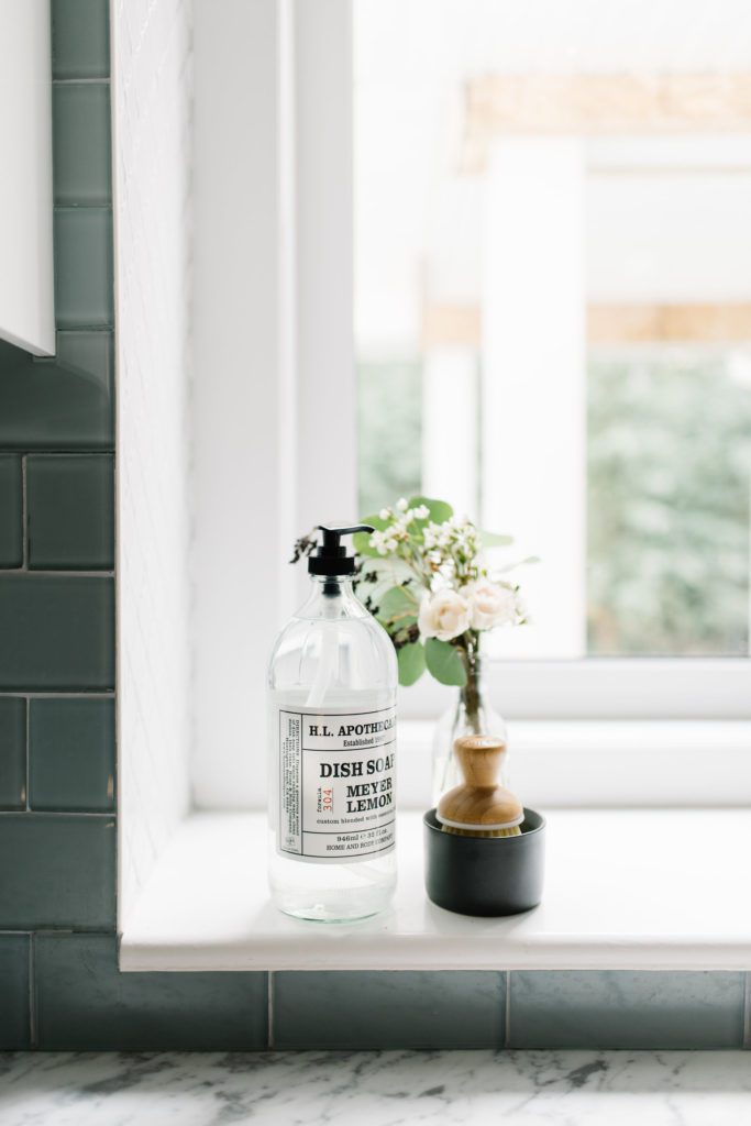 A simple bud vase filled with clippings adds a fall touch to the kitchen window sill