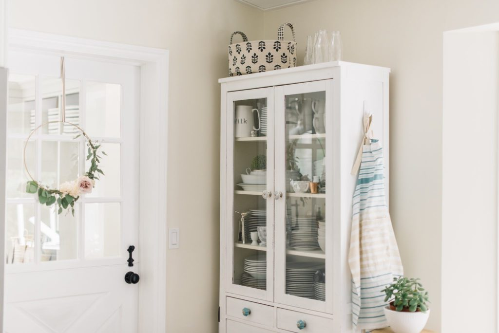 A china cabinet adds extra storage space in this small kitchen/dining area