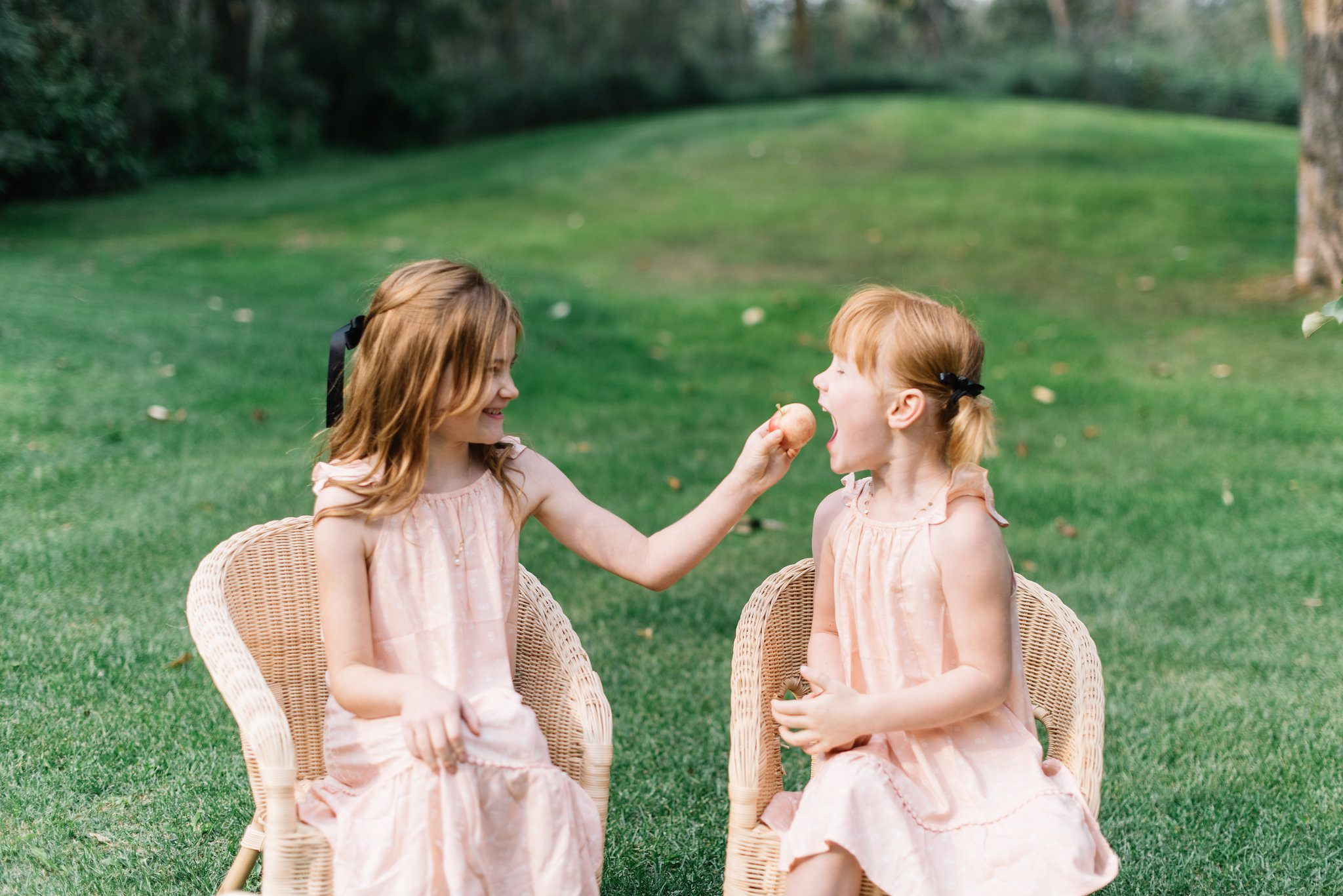 Sisters in matching summer dresses