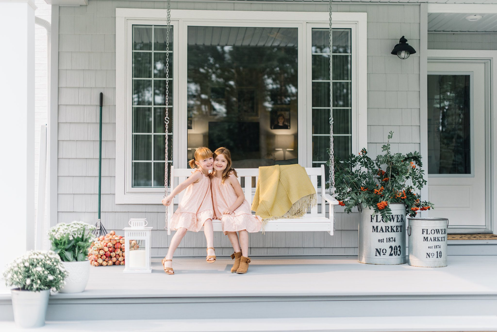Simple Fall home decor ideas such as foraged branches and pots of white mums