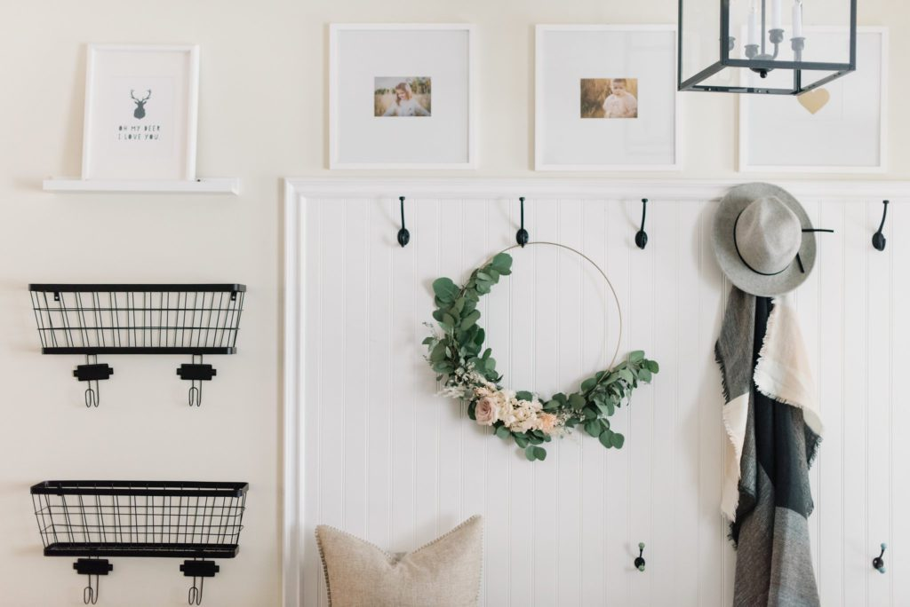 Simple fall decorating idea - a floral hoop in the front entrance adds a pretty and natural touch