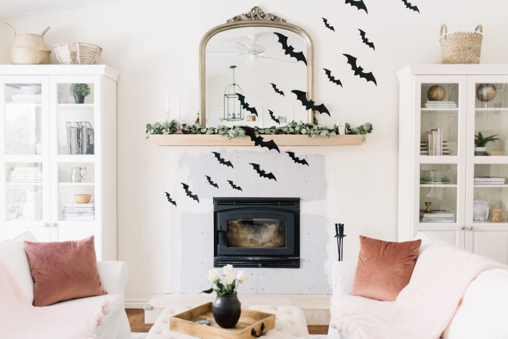 Paper bats fly across the fireplace for Halloween at The Ginger Home