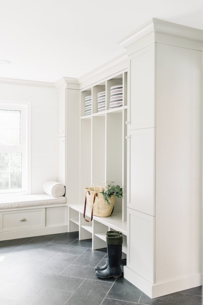 A combination of open and closed storage works well for both convenience and clutter control in this mudroom design