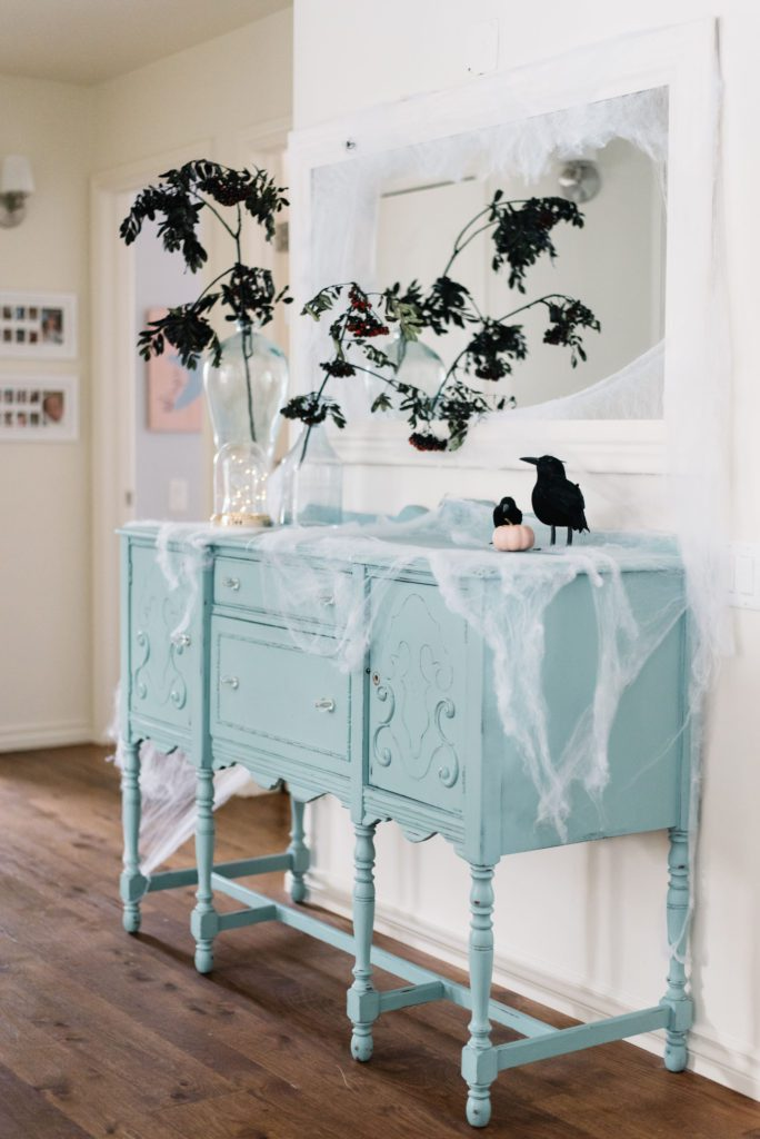 Branches, cobwebs and crows make a spooky hallway vignette for Halloween
