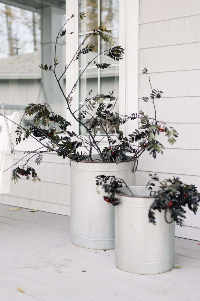 Spray painted branches are a spooky and inexpensive Halloween decor hack