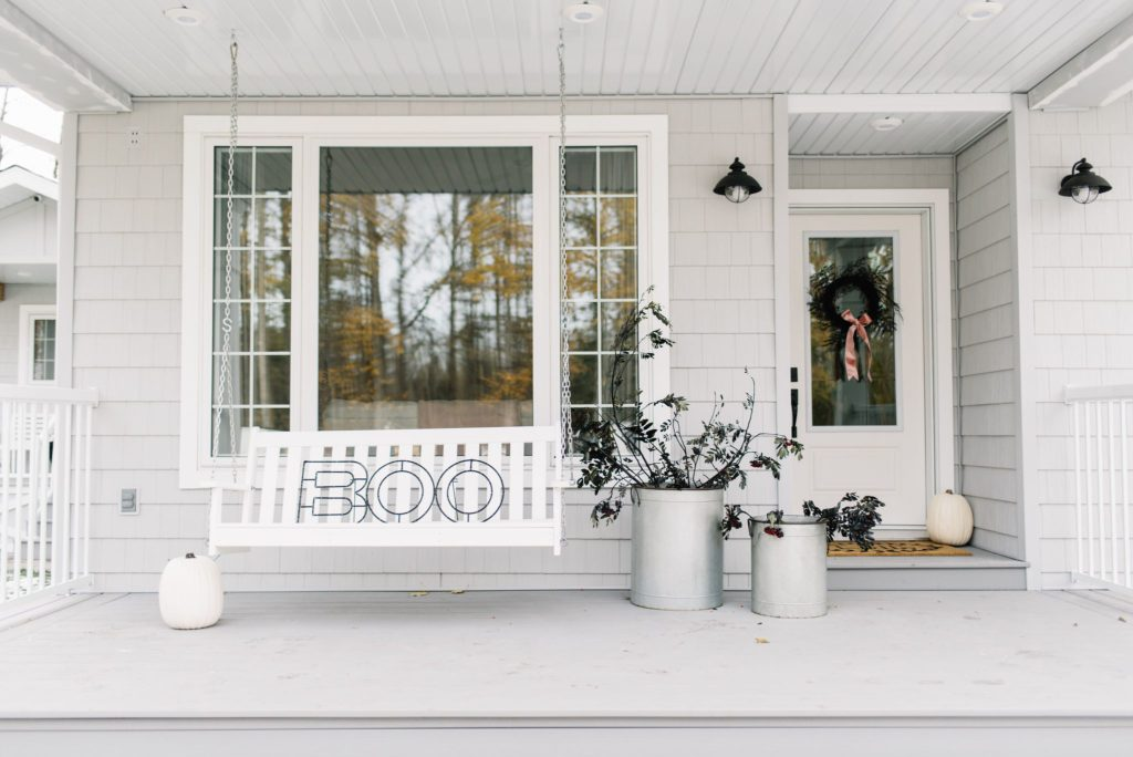 Plastic pumpkins won't rot and look pretty on a Halloween front porch