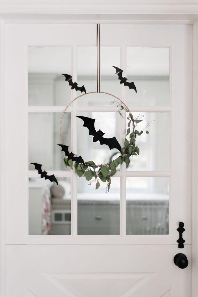 Black bats turn a floral hoop creepy for Halloween