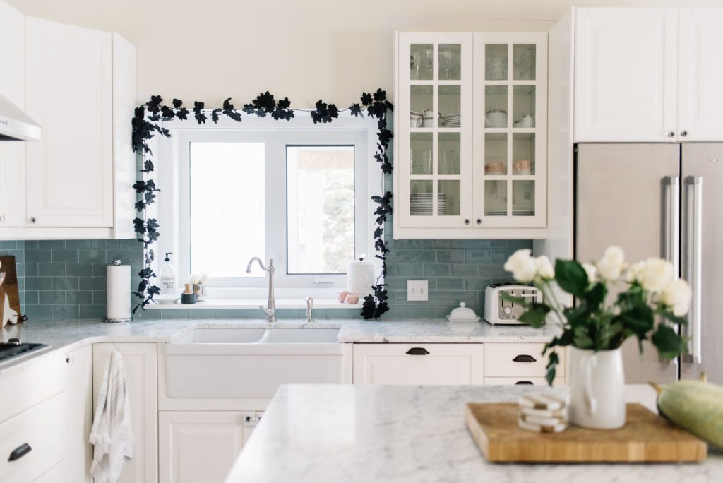 Simple black garland looks luxe in the kitchen for Halloween