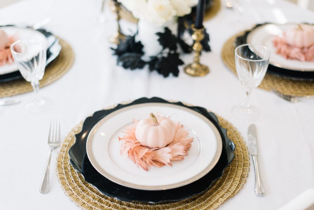 A pretty pink and black Halloween tablescape