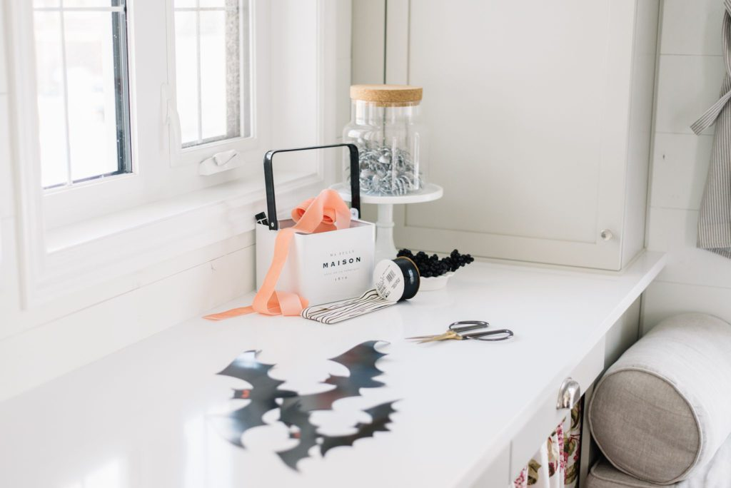 Paper bats from the dollar store make easy and inexpensive decor for Halloween
