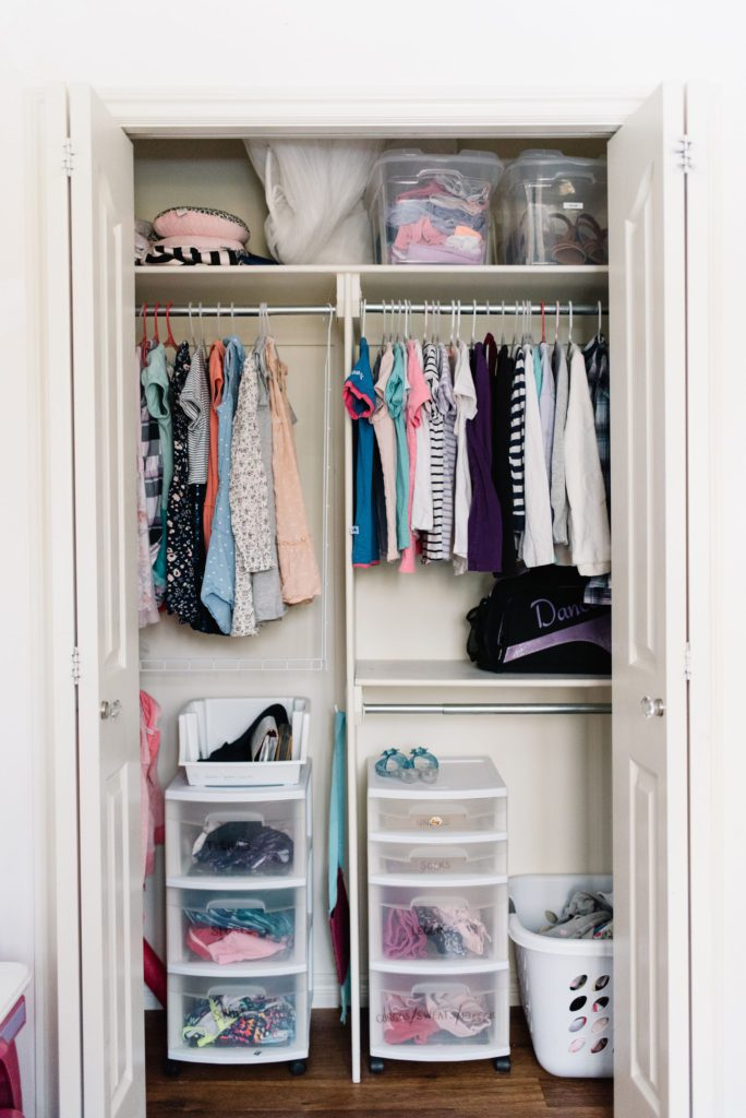 Labelled bins and baskets maximize storage potential in a small closet