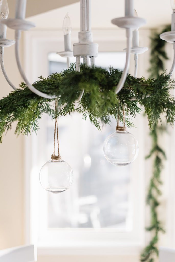 Simple greens hung on the chandelier add a festive touch at The Ginger Home