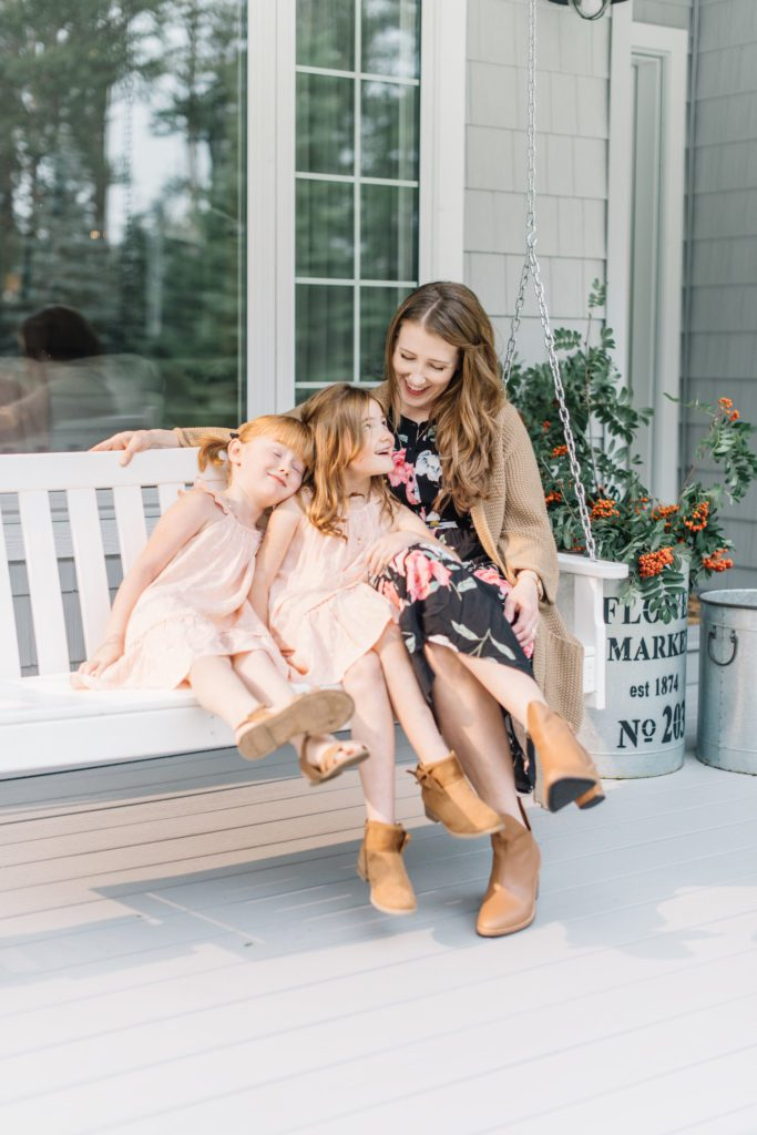 Front porch swings are perfect for family snuggles at The Ginger Home