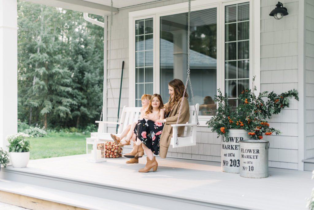 A front porch add outdoor living space to a small home making it feel larger.