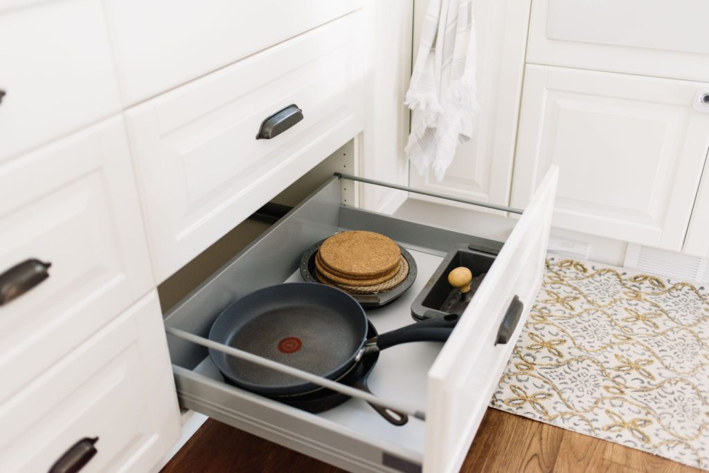 Drawers under the cooktop hold frying essentials