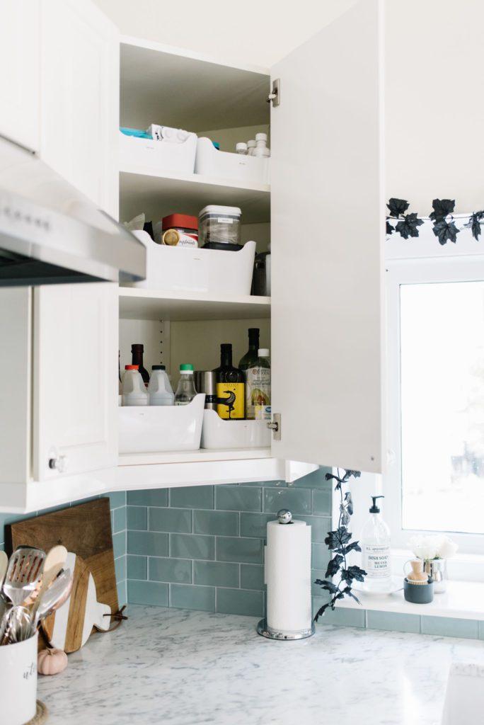 Labelled bins make storage easier in high kitchen cupboards