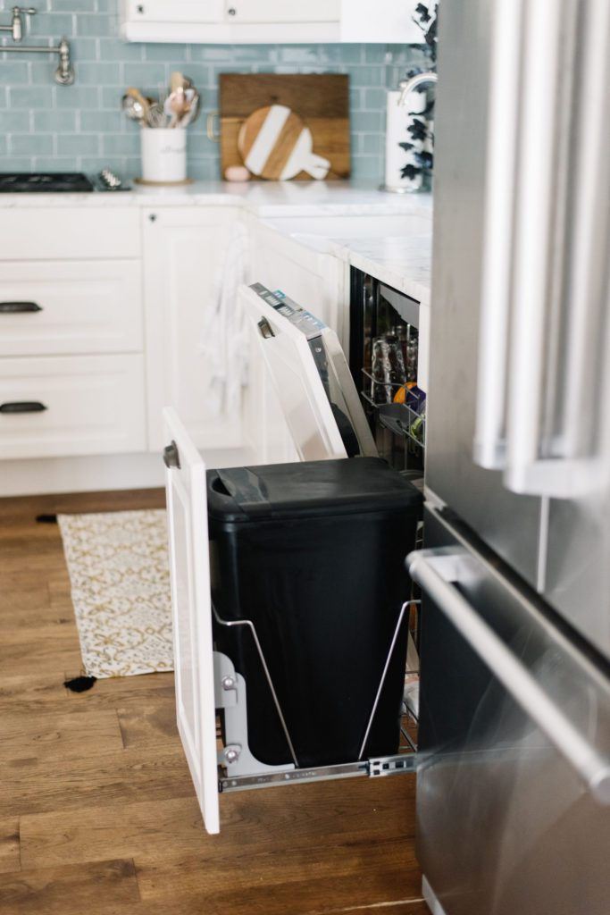 Hiding the garbage and dishwasher make this small kitchen feel much larger