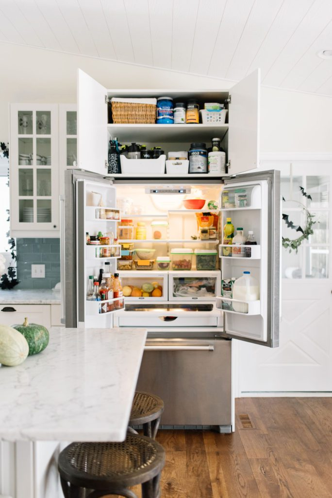 Small space living can sometimes require smaller appliances and furniture, like this counter depth fridge