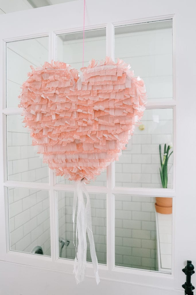 Valentine's Day Decorating Idea - A handmade pink heart pinata