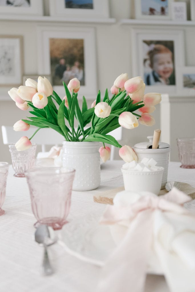 A pretty Valentine's Day Table setting with faux tulips and pink linens