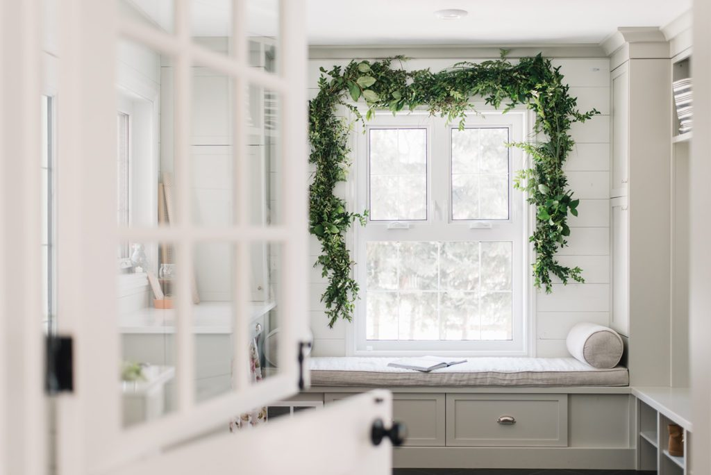 fresh green garland in the mudroom for Spring decor