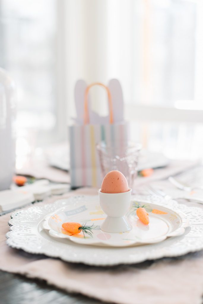 easter table setting with faux eggs in eggcups