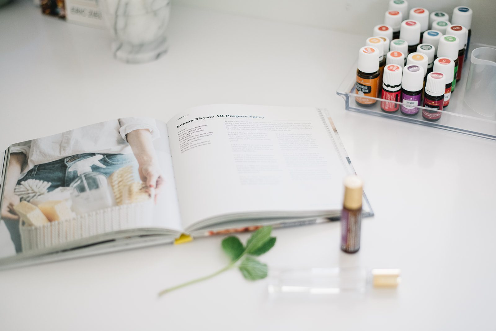 essential oils and book on counter