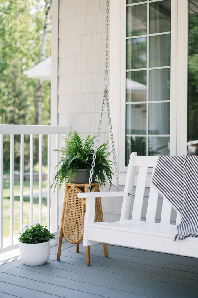 A simple summer porch with swing, plants and flowers