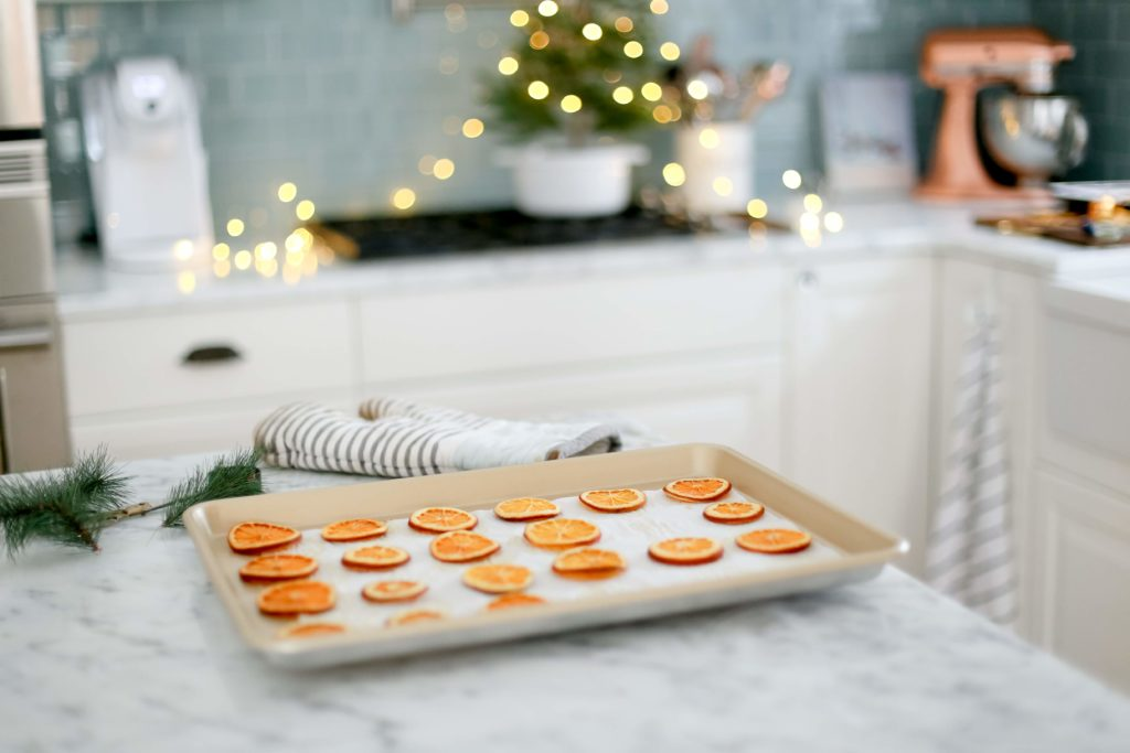Dried orange slices on a baking tray
