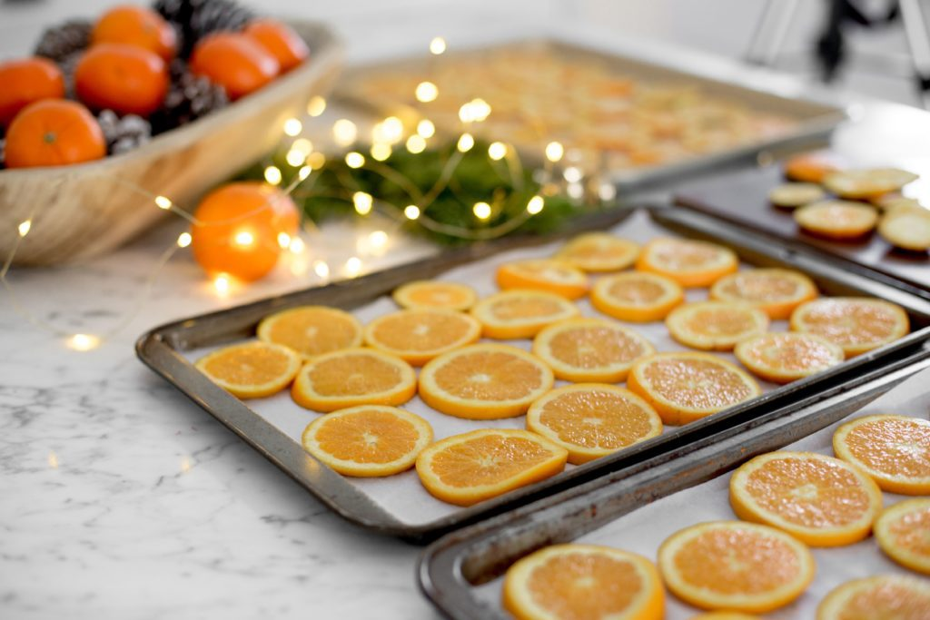 Cut up fresh oranges and dry in the oven to make pretty Christmas decorations