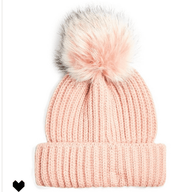 You'll feel the holiday cheer in this cute and colorful pom pom hat!