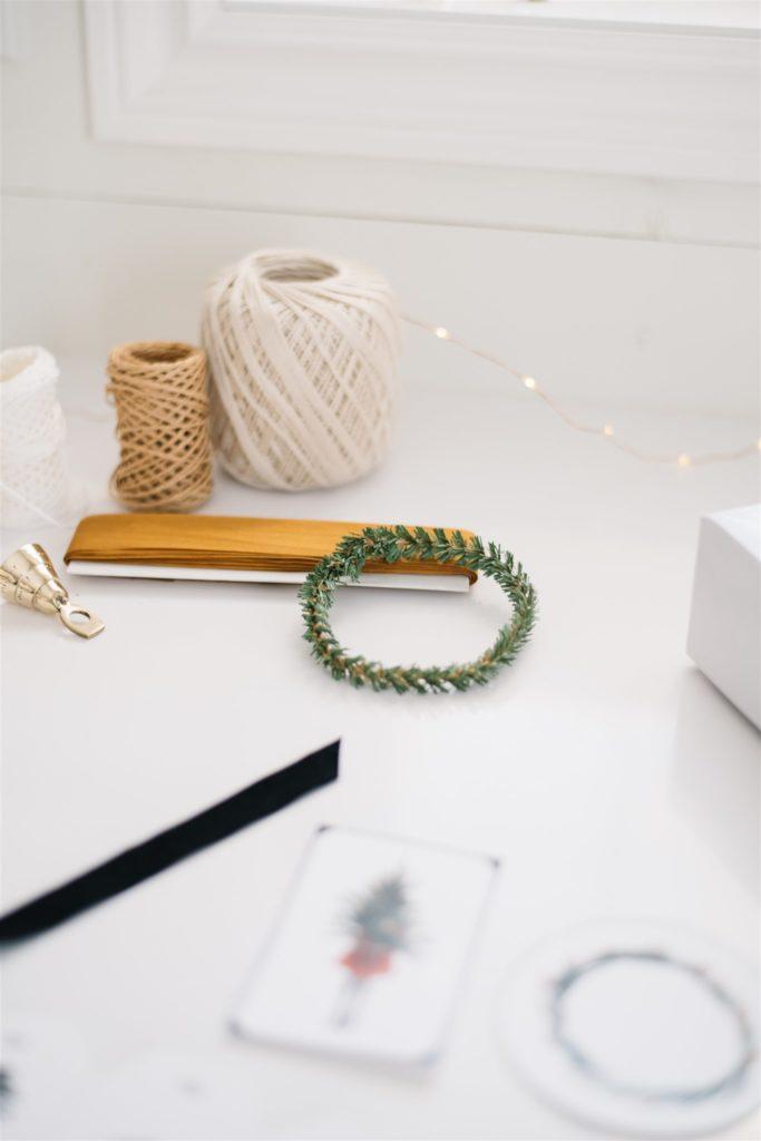Use embellishments to make plain bags pretty gift bags
