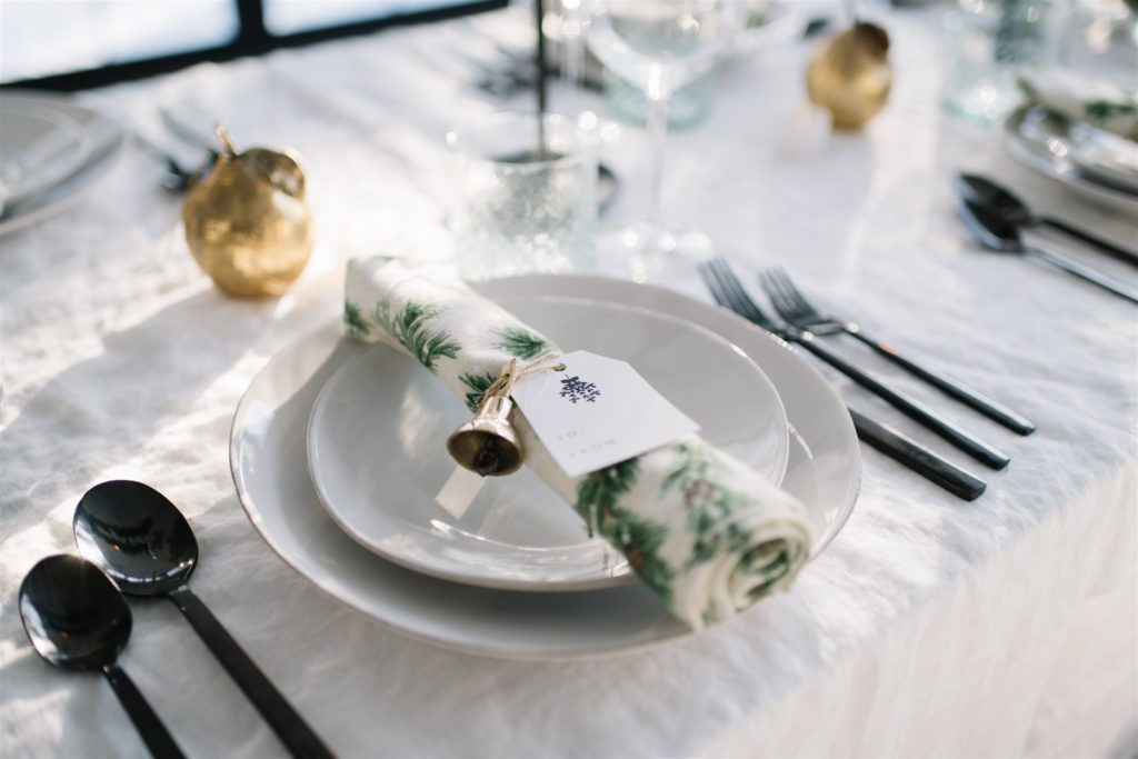 Adding setting the table with name tags to your holiday hosting checklist to make guests feel welcome