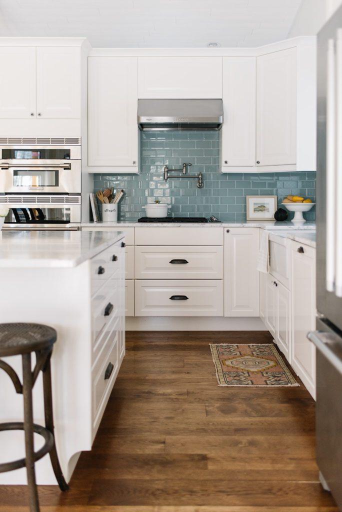 Bright white farmhouse kitchen with marble countertops