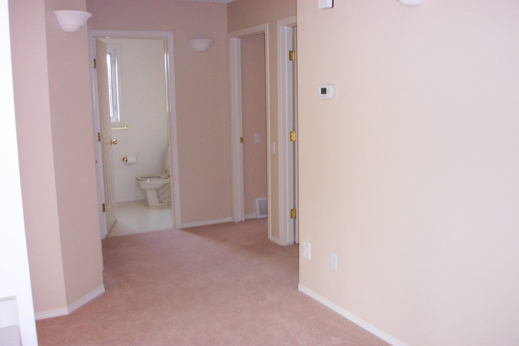 a dated hallway in need of renovation