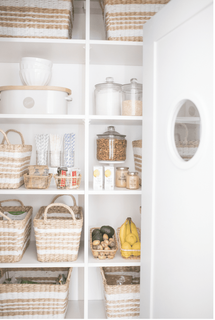 a beautiful pantry organized with woven baskets