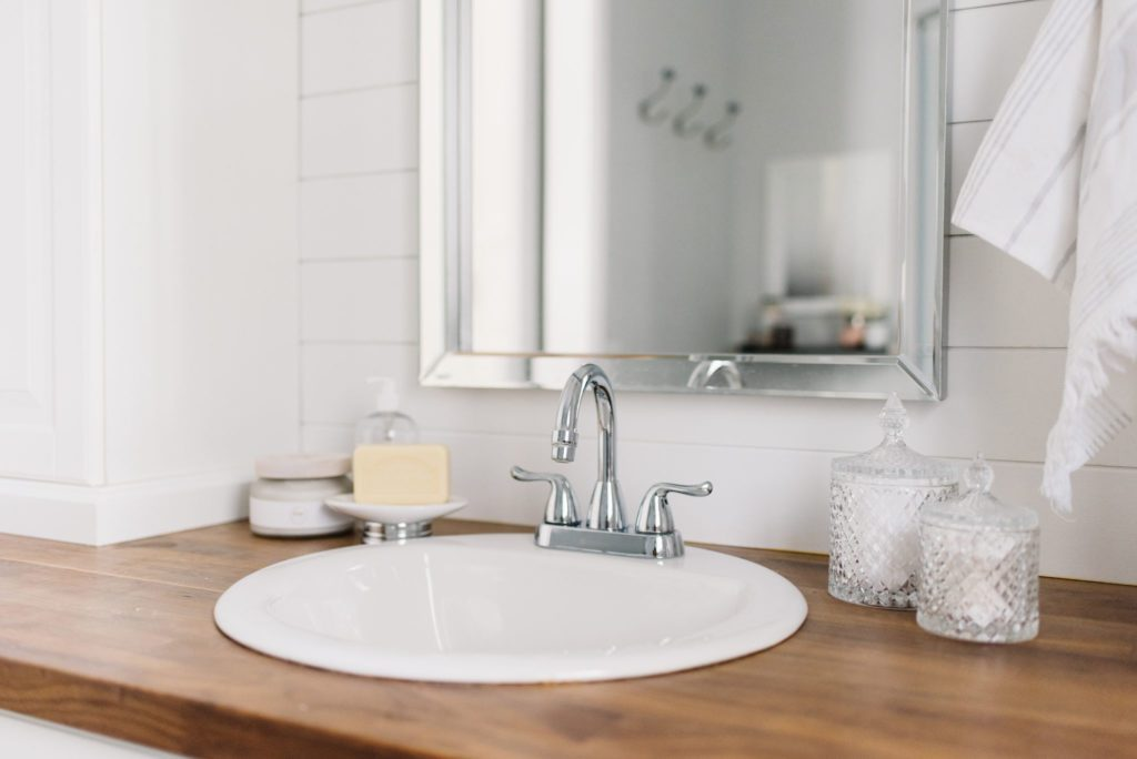 keep a tiny master bathroom uncluttered with simple accessories