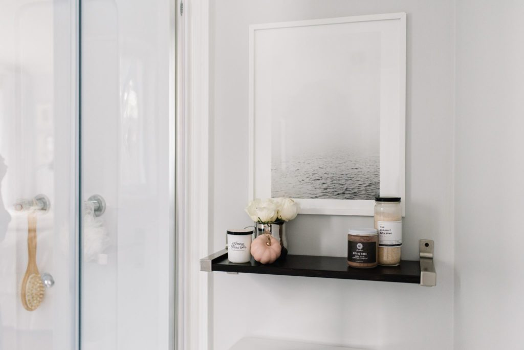 A tiny master bathroom feels light and airy with simple accessories