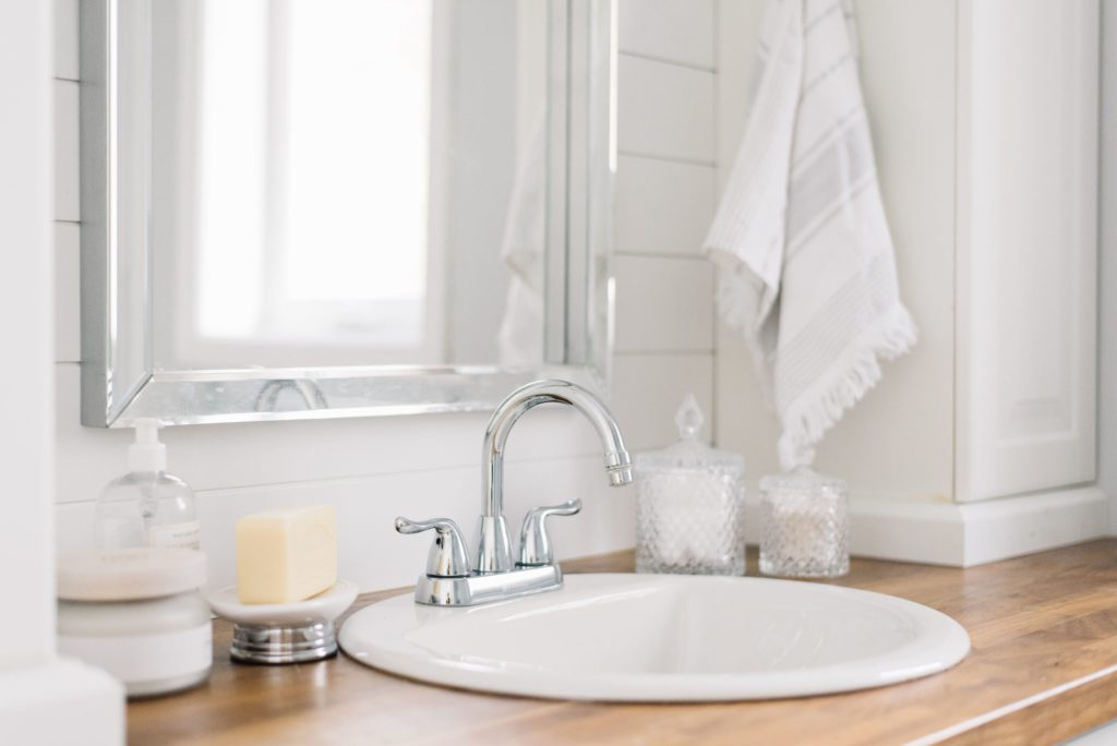 A small sink allows for extra counter space in a tiny master bathroom