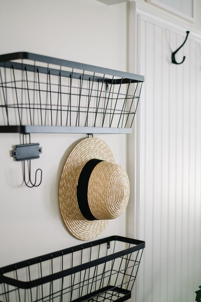 baskets on the wall provide storage in this small entryway