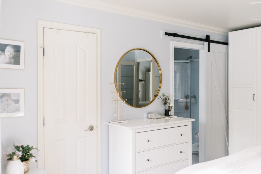 The bathroom door is a sliding barn door to save space