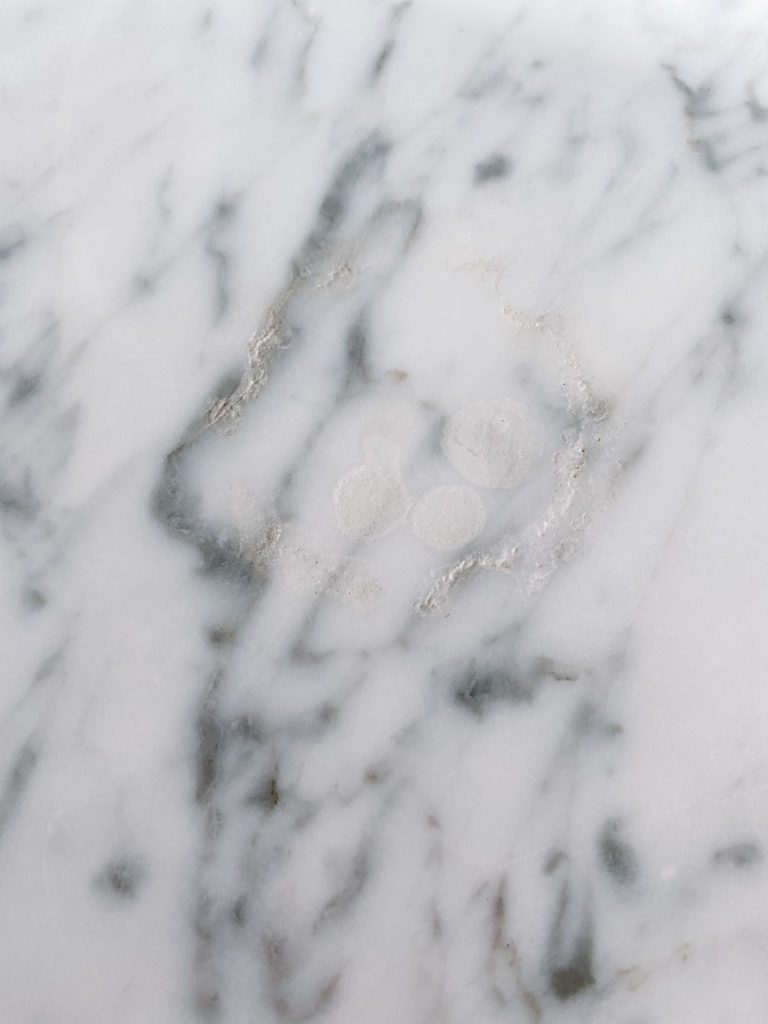 Large etch on marble counter