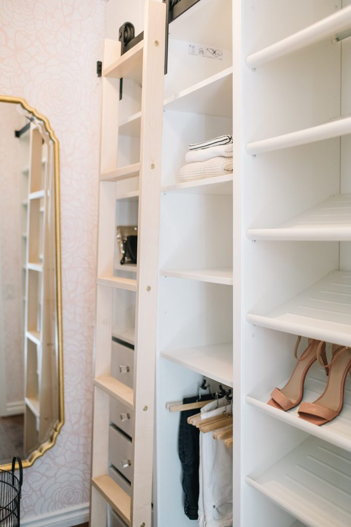 rolling library ladder in a small master closet