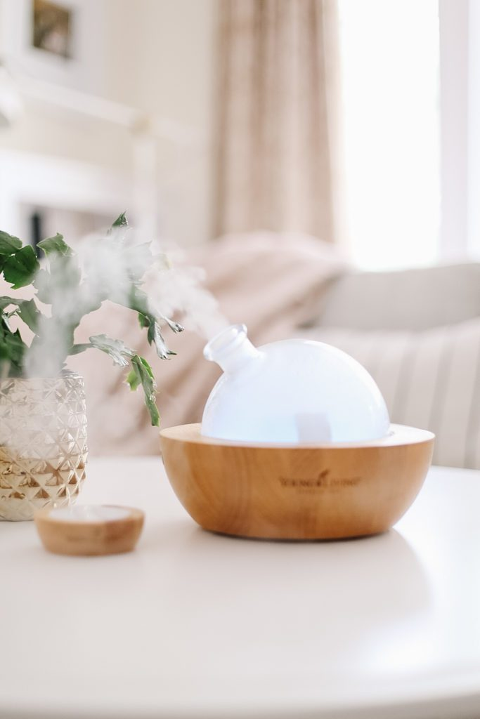 A glass diffuser diffusing essential oils