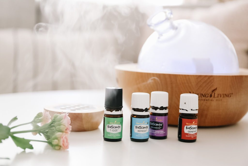 oils for kids beside glass diffuser