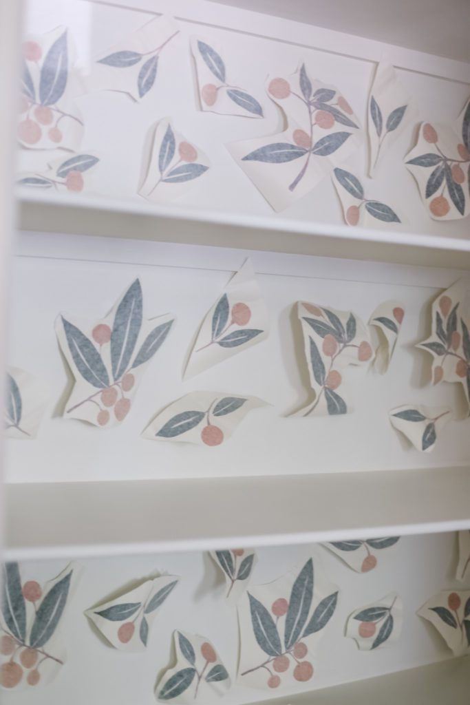 tangerine wall decals placed on cupboard wall