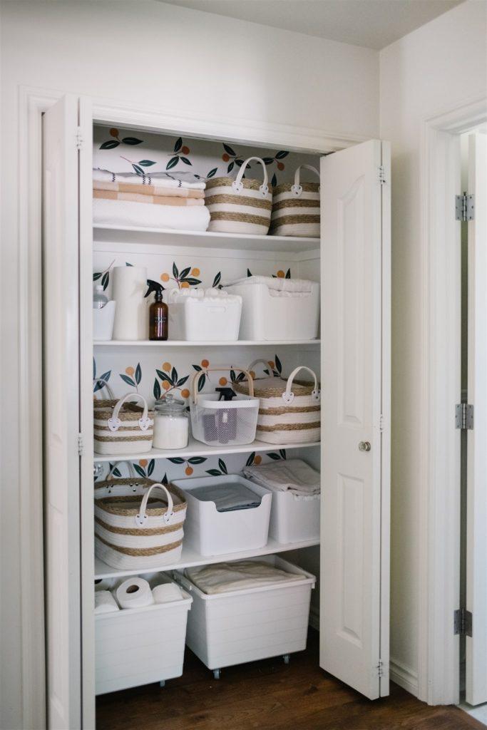 An organized hall linen closet
