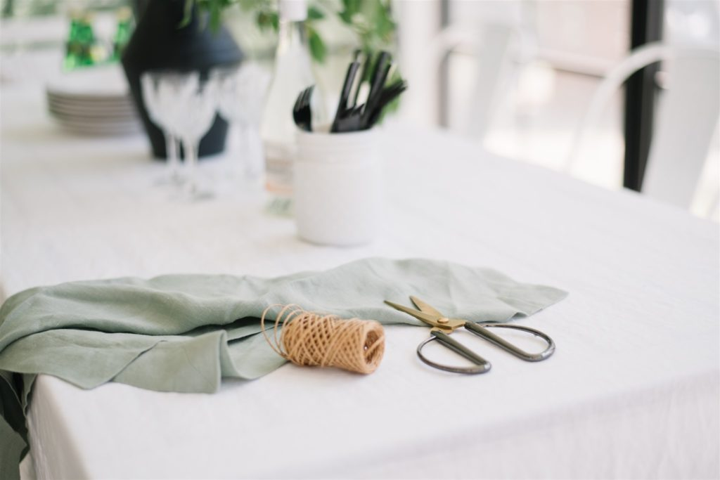 scissors and twine to attache to linen napkins