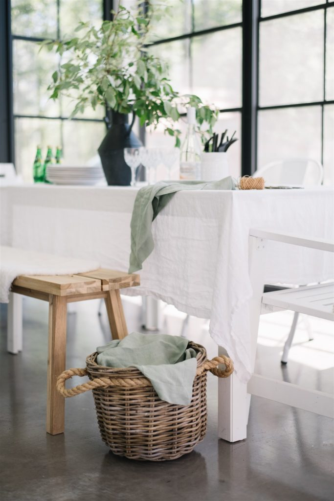 Summer tablescape with linen and natural wood tones